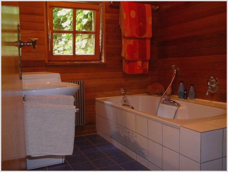 Использование плитки в деревянном доме: монтаж своими руками